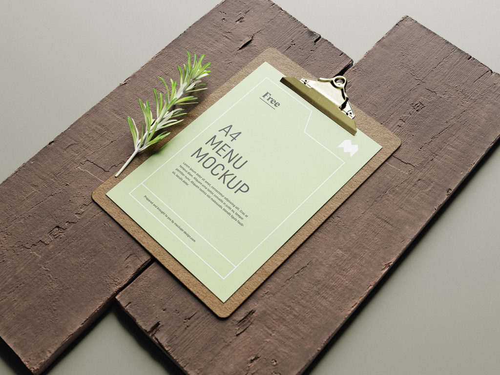 menu mockup free on clipboard and with wood background